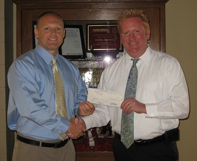 JJ Paul Presents Check to Brent Davidson of Bama Dining